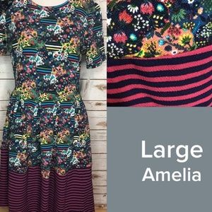 LulaRoe L Amelia Floral with Striped Dipped Bottom